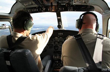 Pilot and Copilot sitting in the cockpit of a flying plane