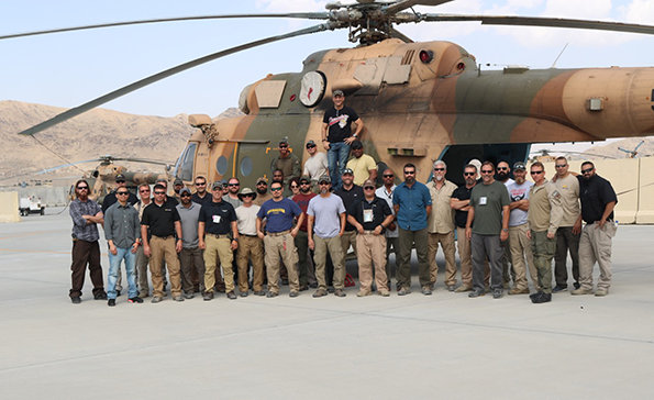 Kabul Team in front of a helicopter